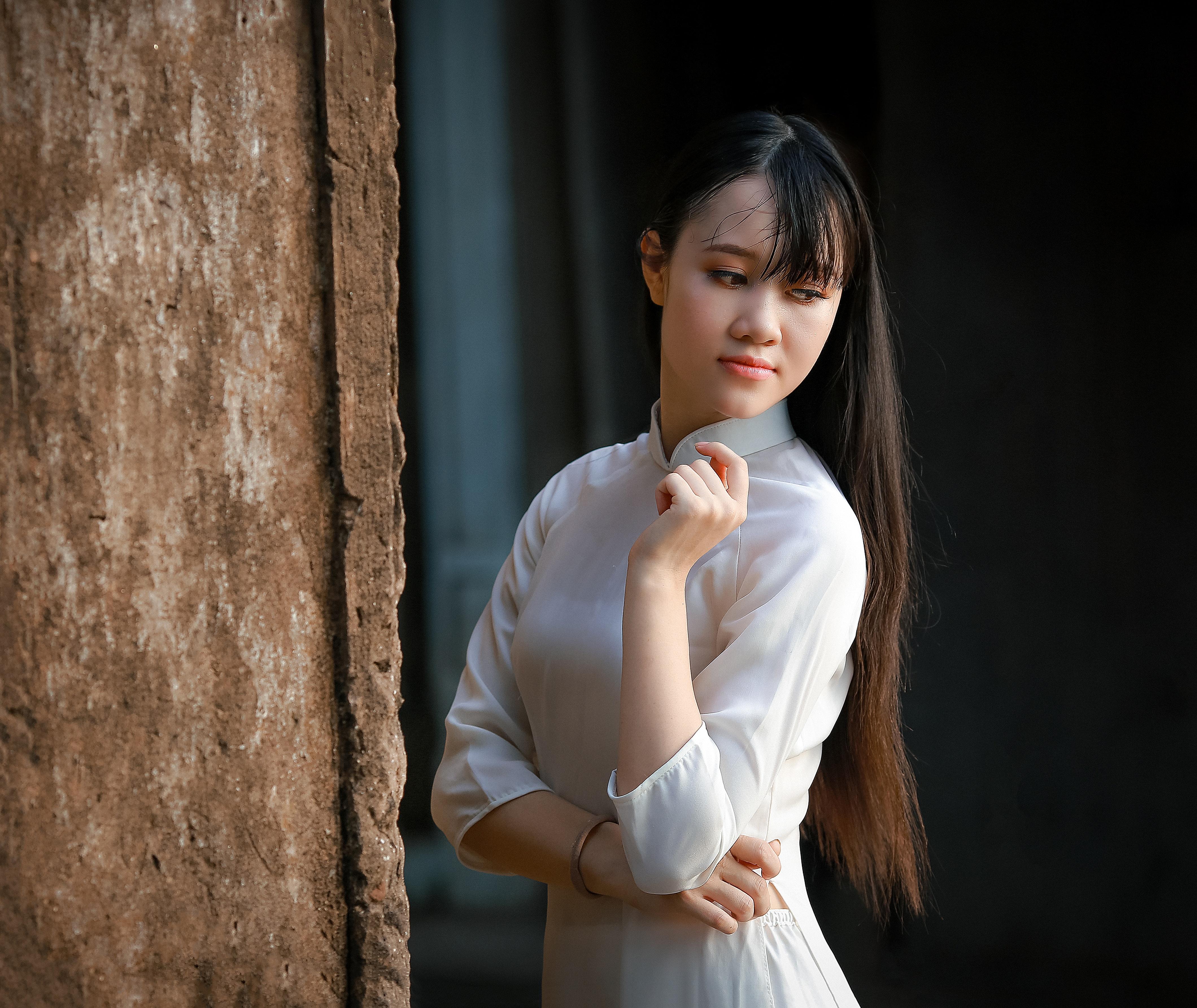 Women in white long-sleeved dress photo
