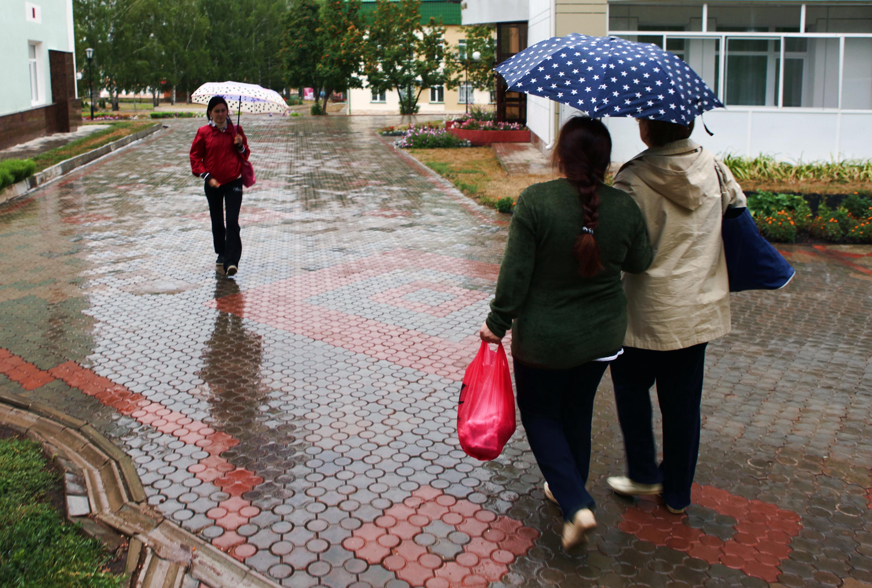 Women with umbrellas photo