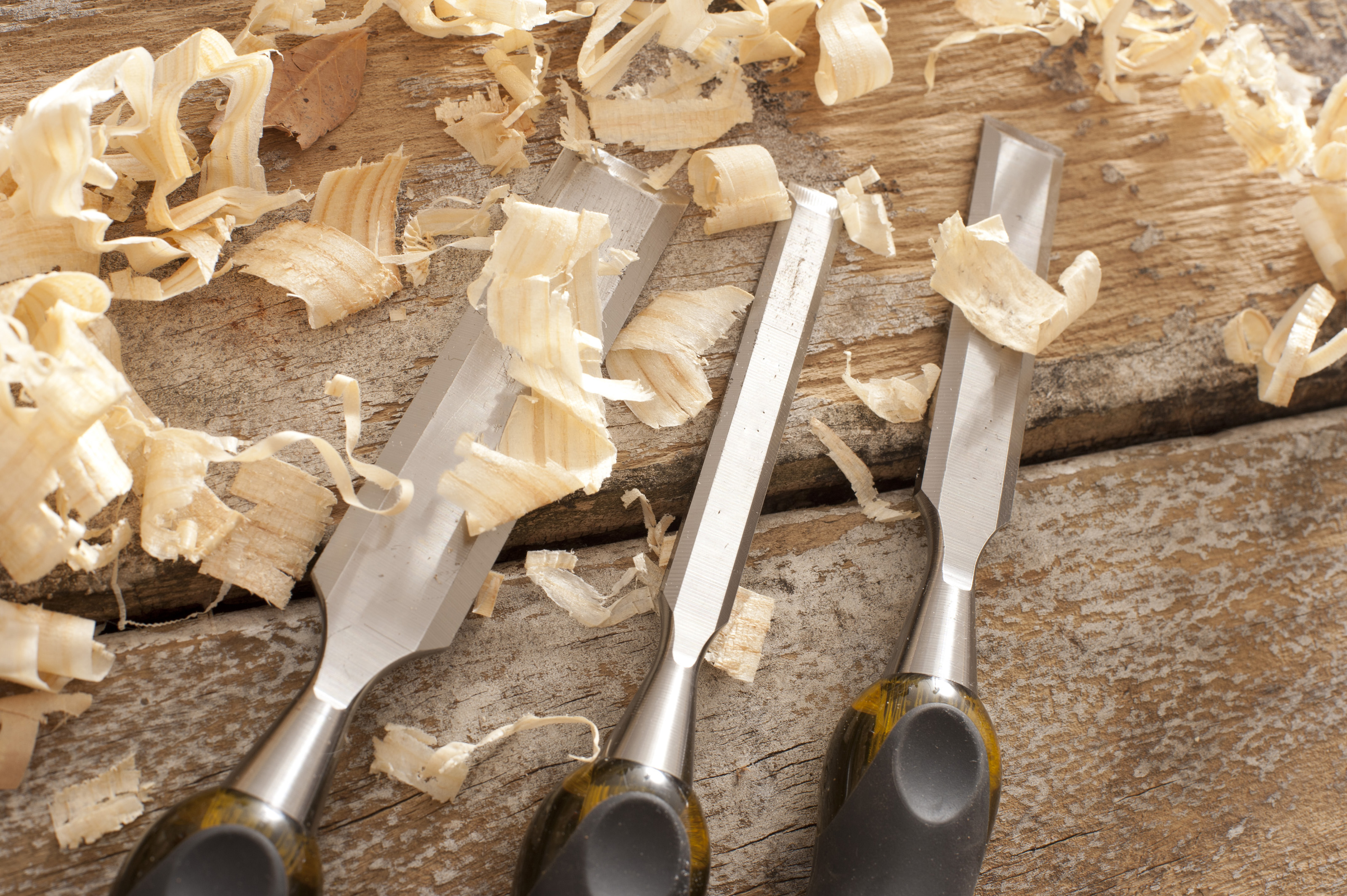 Free image of Wood Chisels Surrounded by Wood Shavings