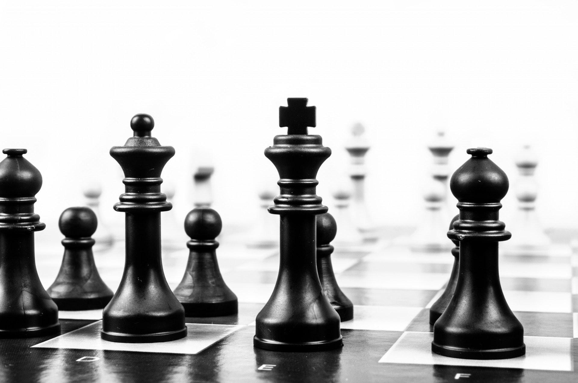 Wooden black chess piece photo