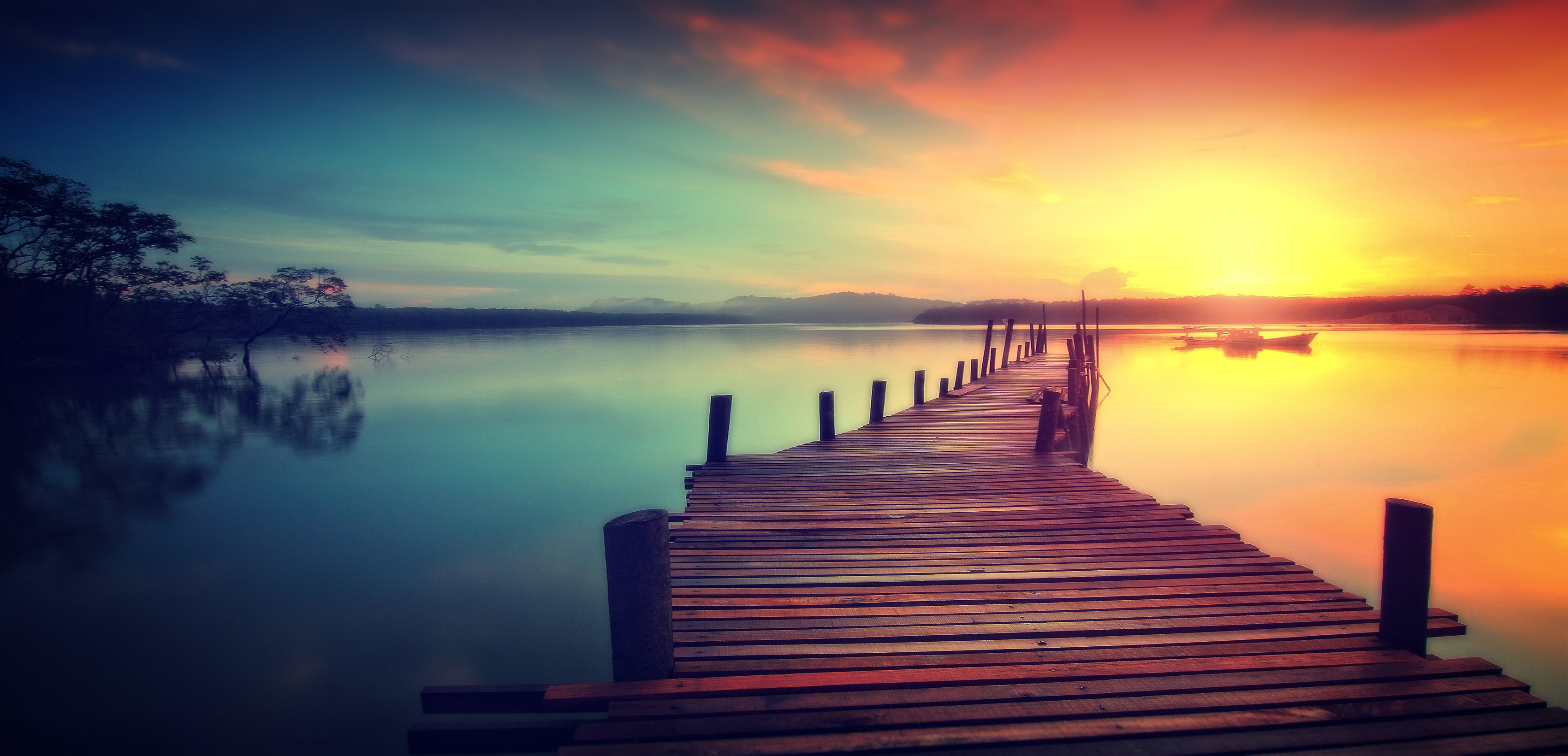 Wooden jetty at sunset - dreamy looks photo