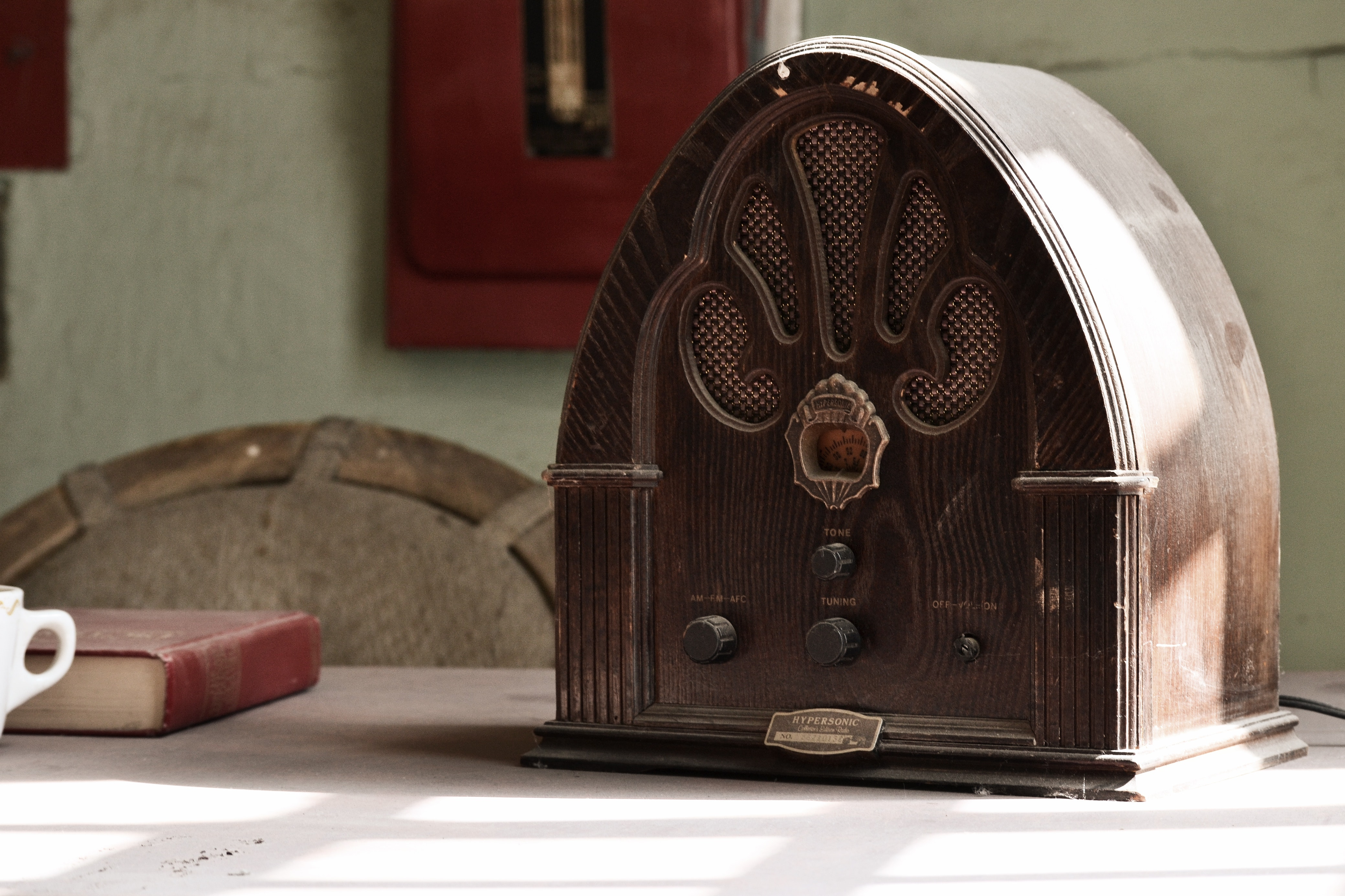 Wooden retro radio on a table in an old room photo
