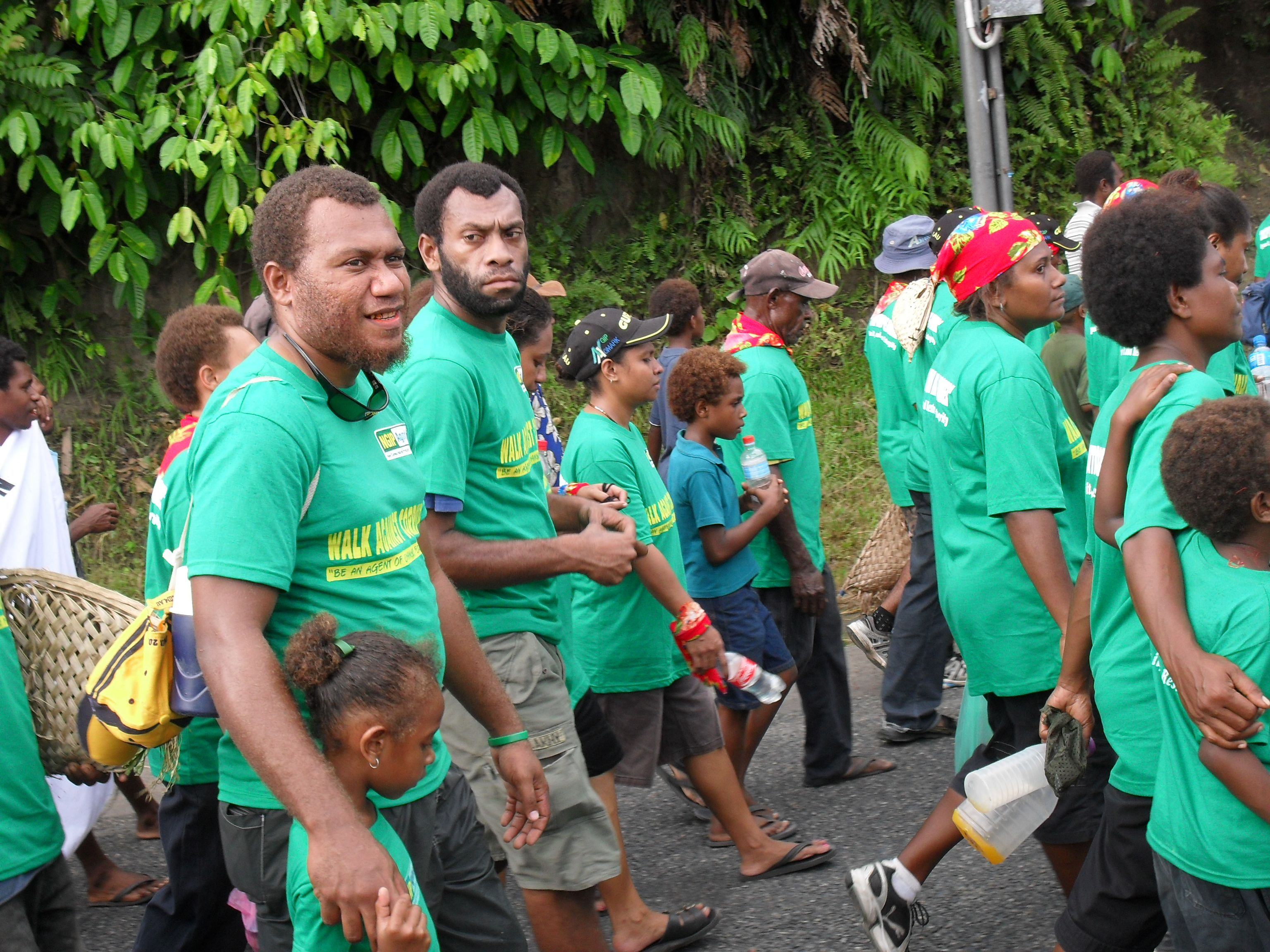 Workers walking against corruption photo