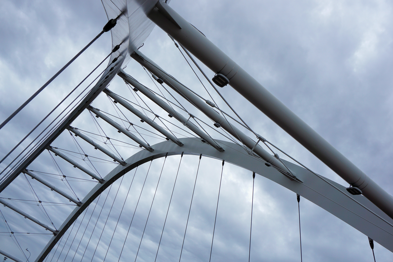 Worm's eye view of grey steel bridge photo