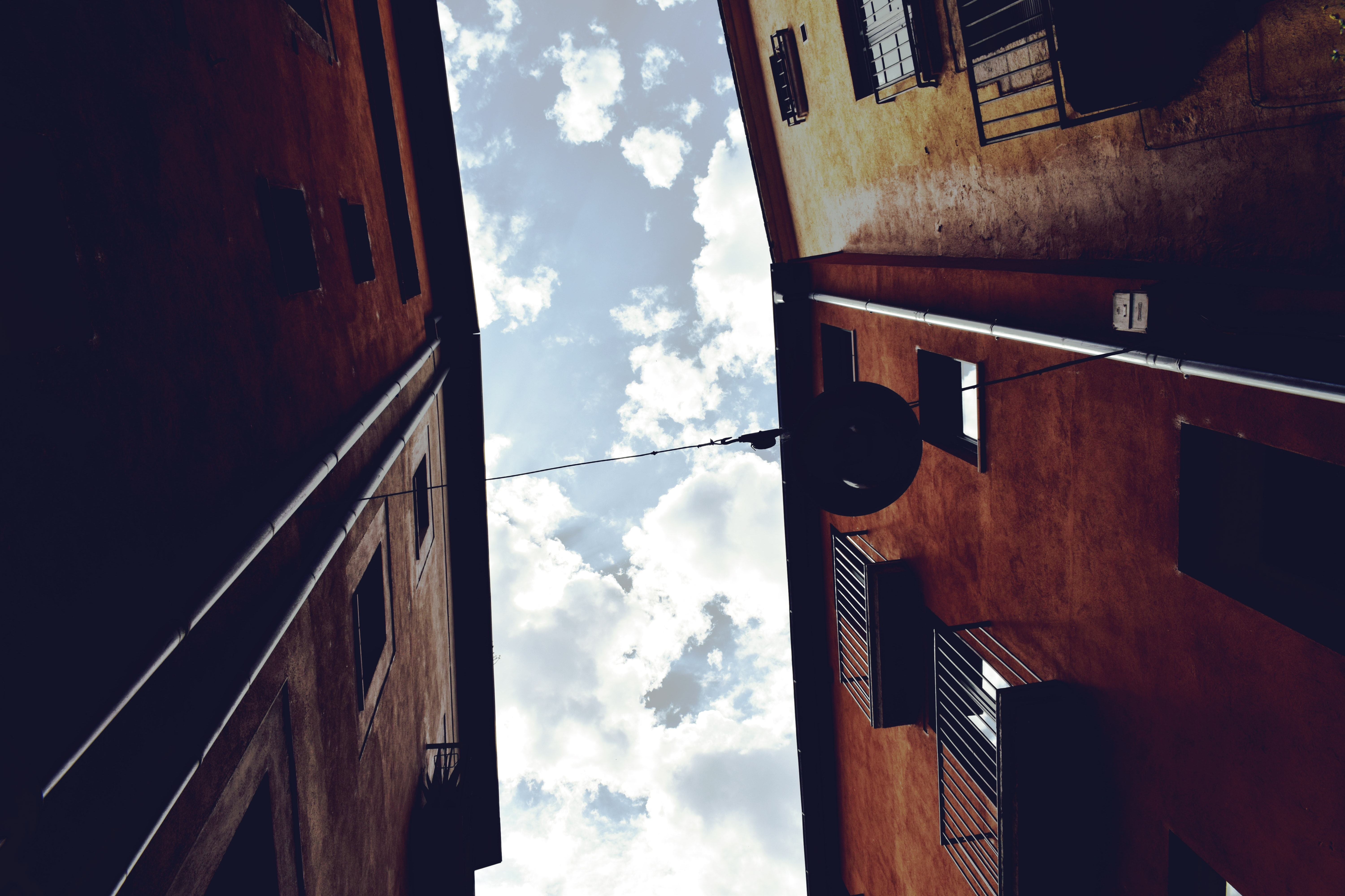 Worm's Eyeview Photography of Brown Concrete Building and White Clouds, Alley, Light, Urban, Travel, HQ Photo