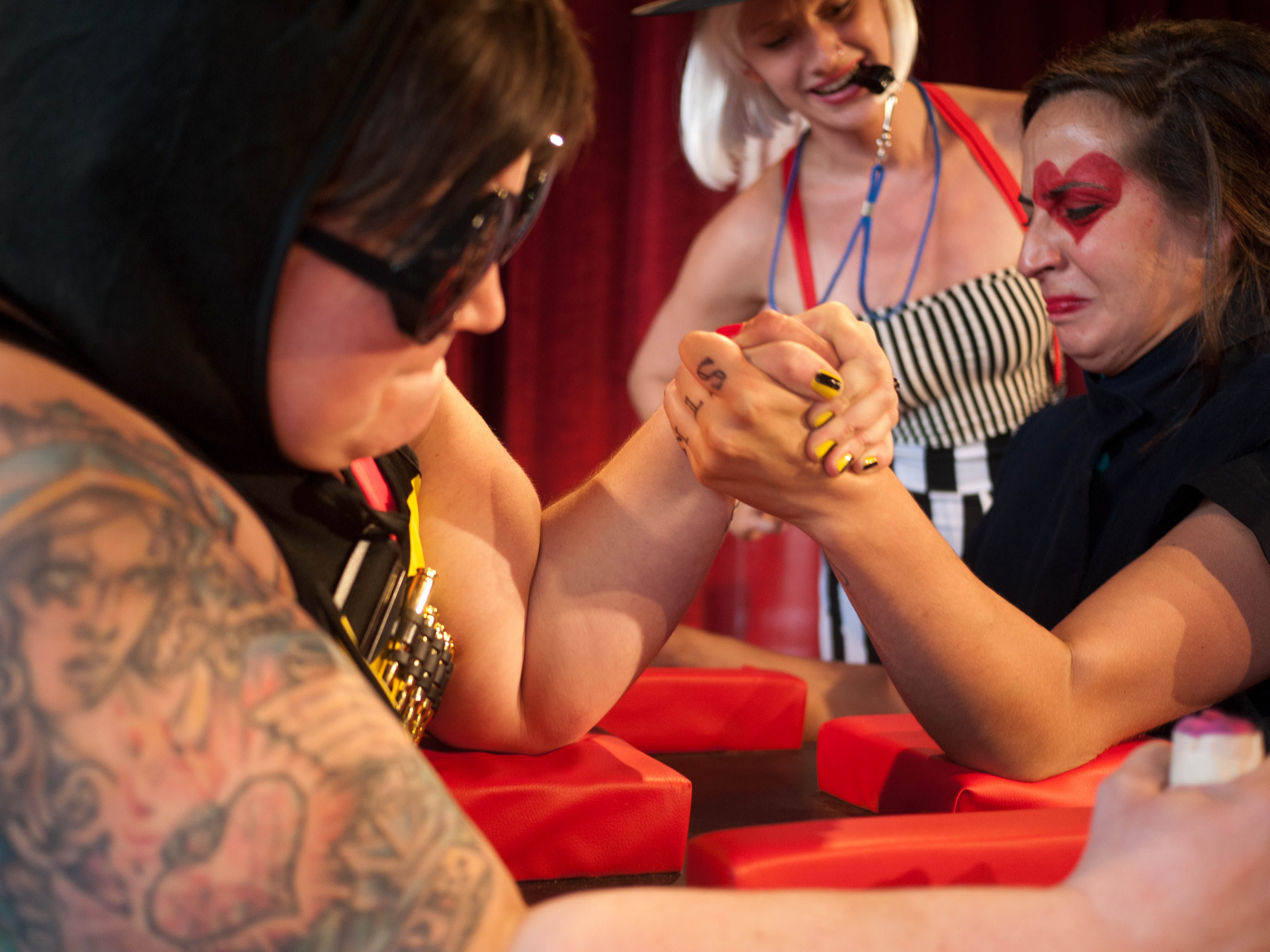Watch This Lady Arm Wrestler Destroy Her Opponent AND a Very Large Onion