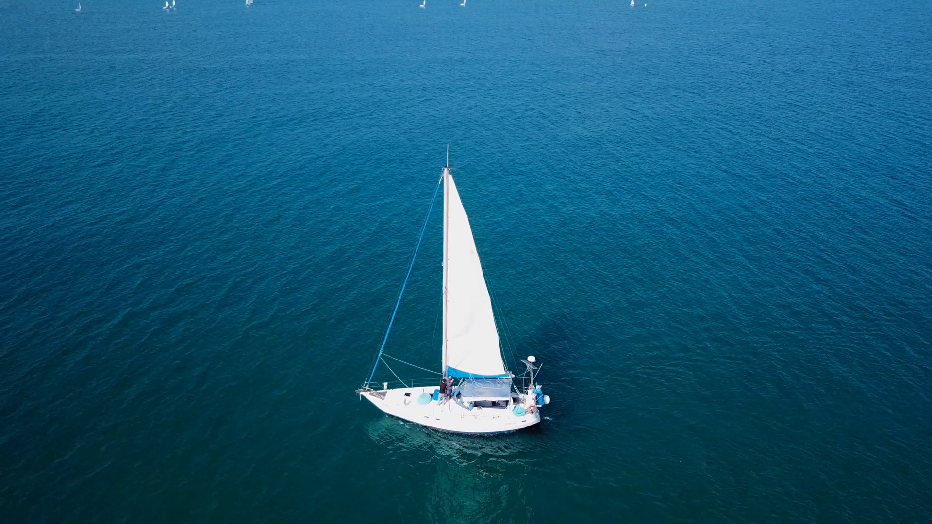 Small white sailing yacht at sea - Top down aerial footage Stock ...