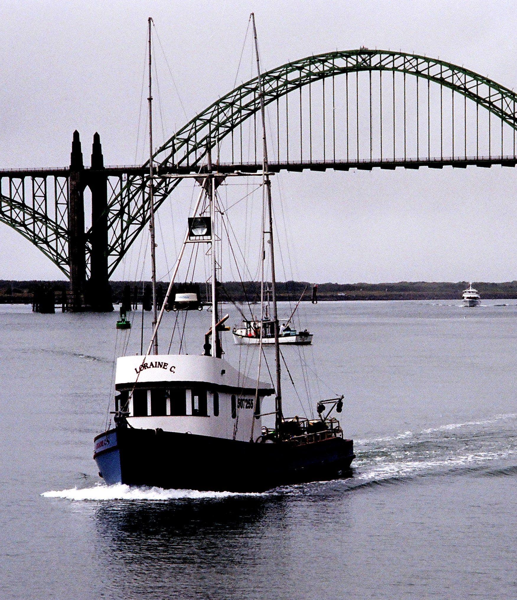 Fishing boat at Yaquina Bay Bridge, Newport, Oregon. See more photos ...