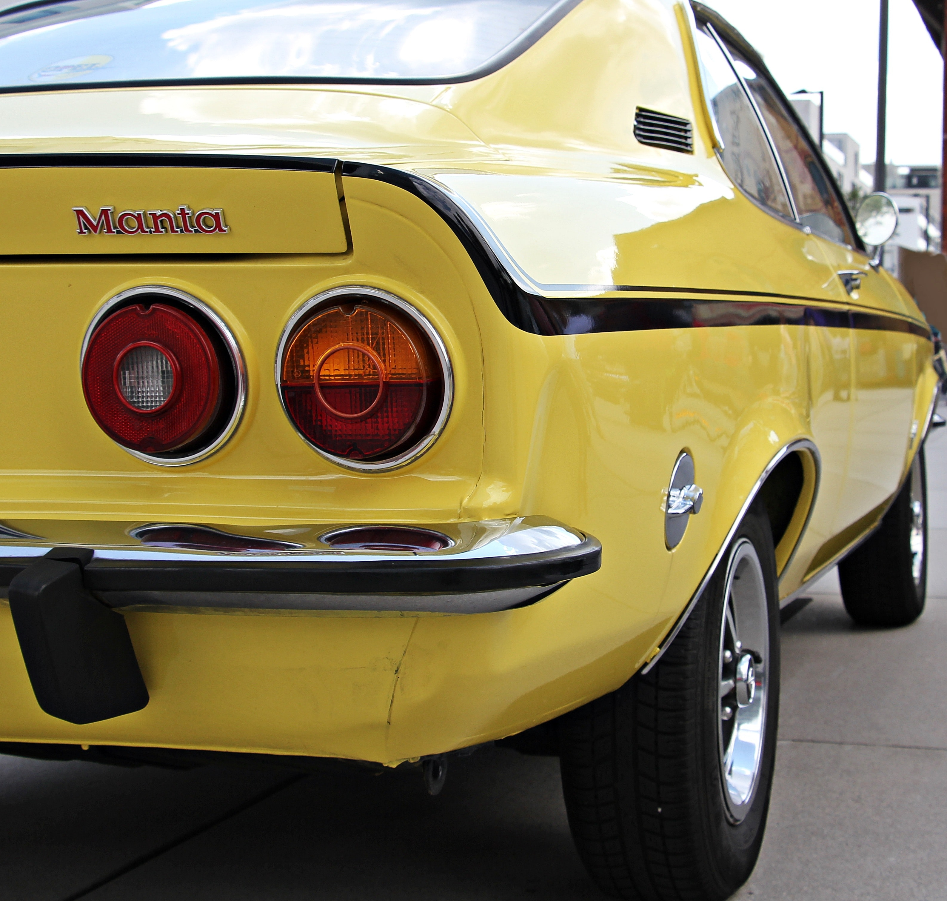 Yellow and black muscle car parked during daytime photo