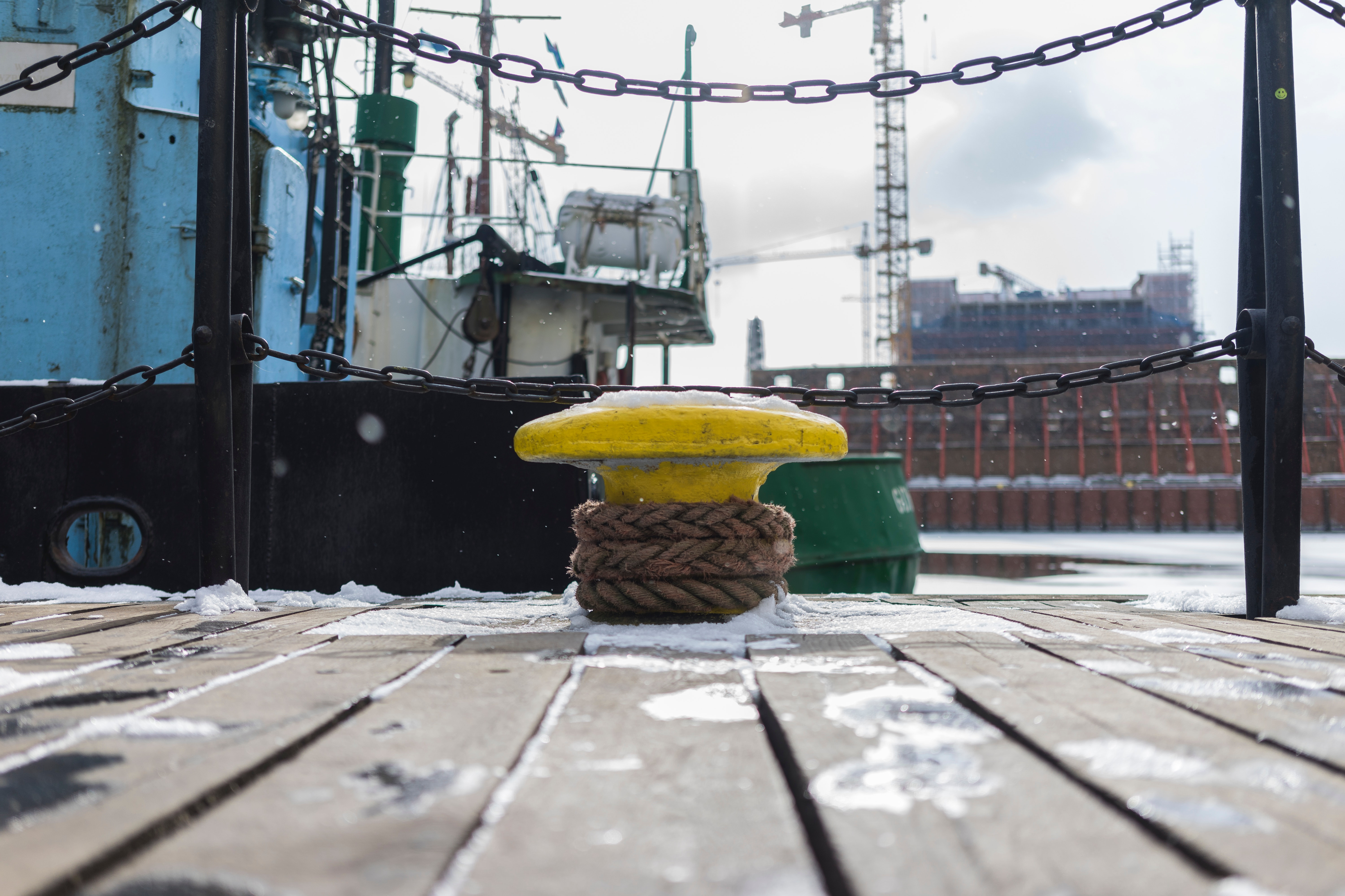 Yellow anvil beside green boat photo