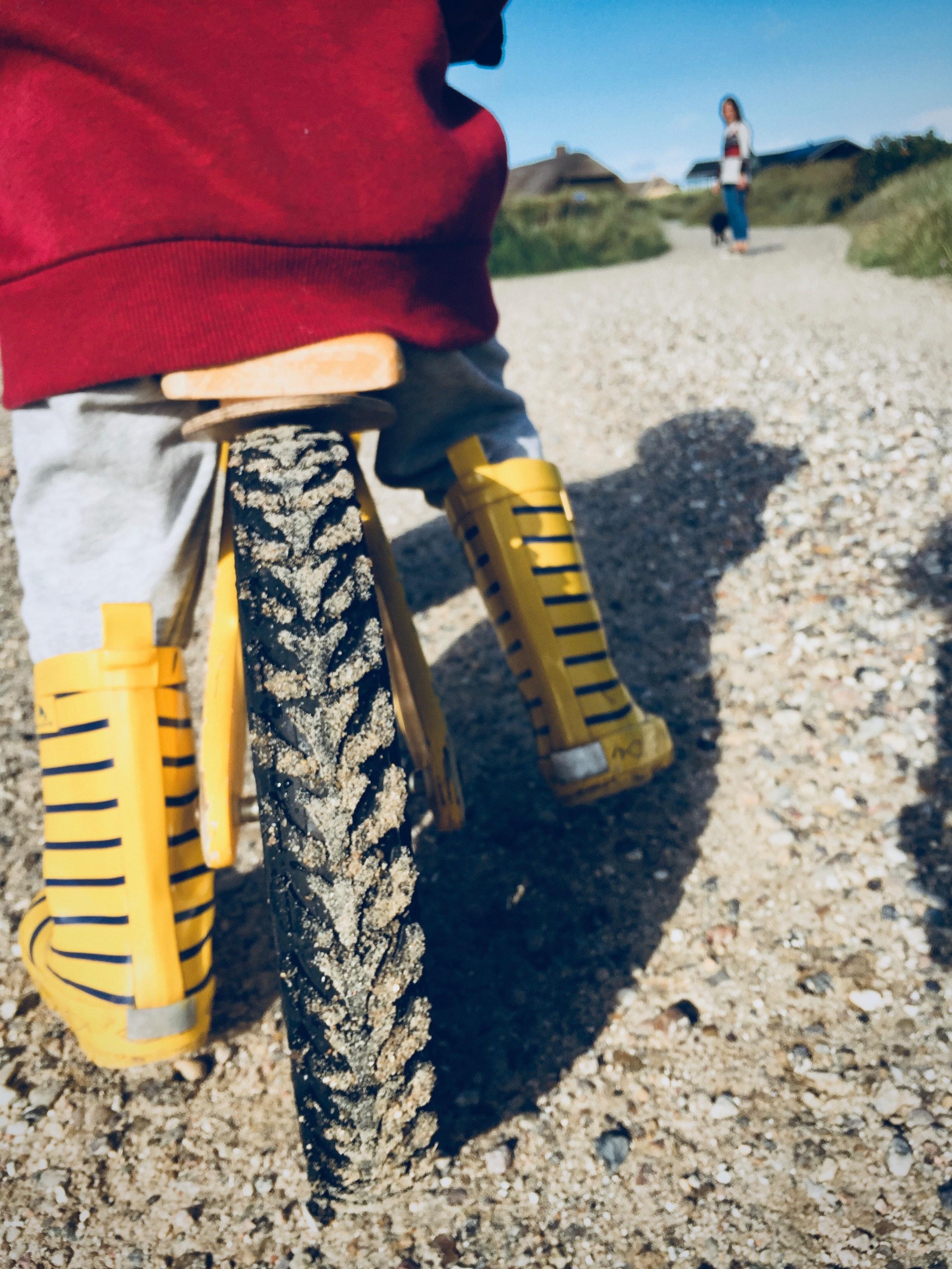 Yellow bicycle on brown sand photo
