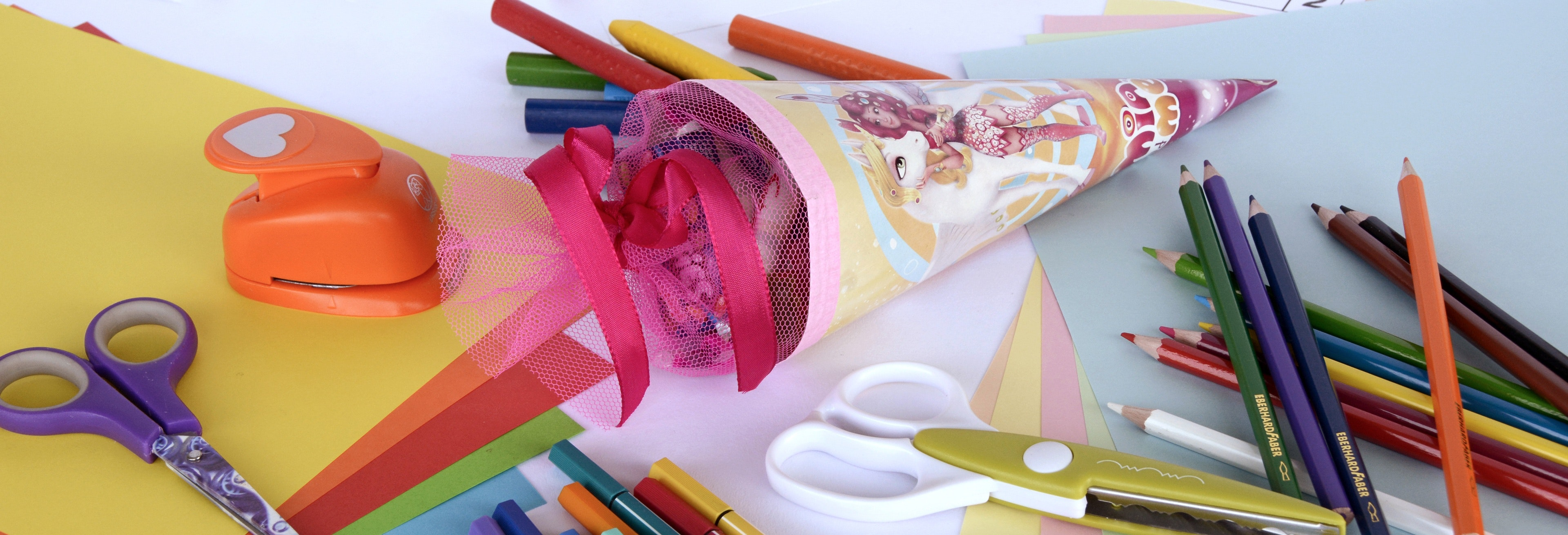 Yellow blue black purple red and brown coloring pencil near on white and green scissors photo