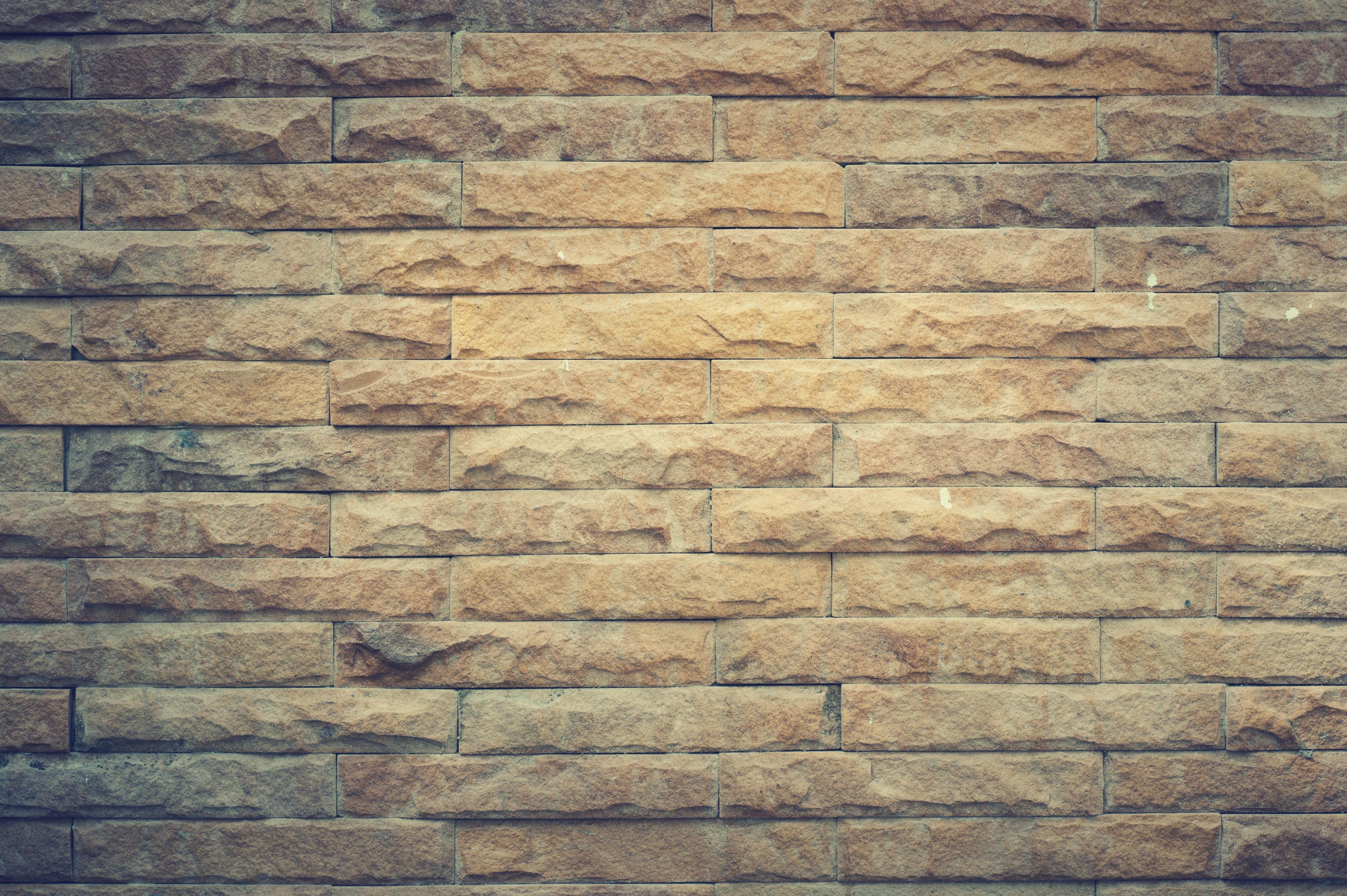 Yellow brick wall photo