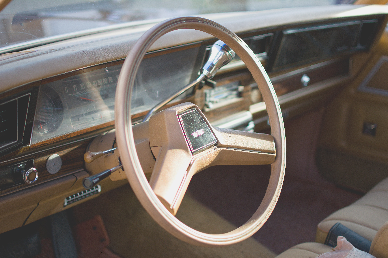 Yellow car steering wheel photo