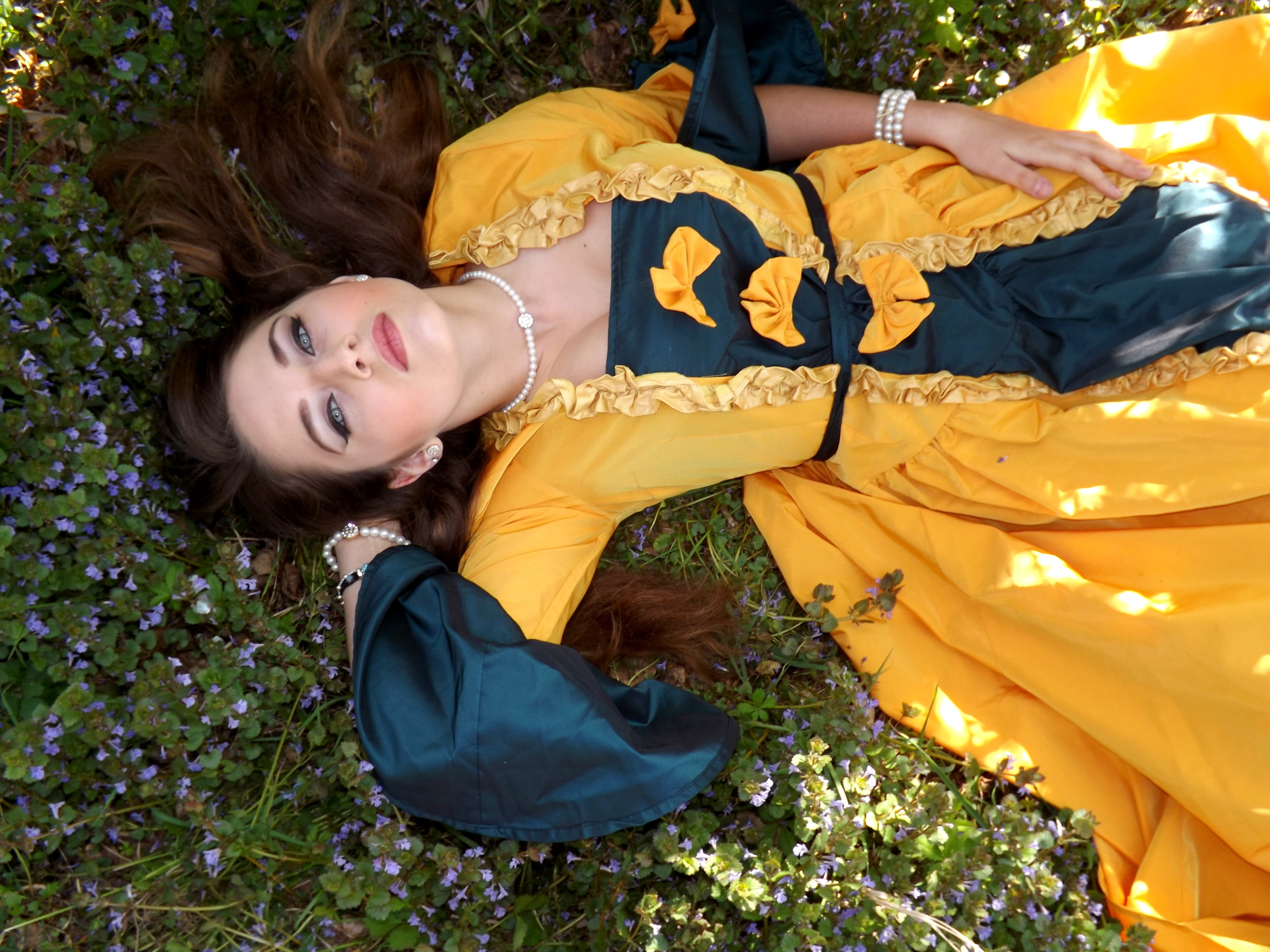 Yellow dressed woman on green leafed plant photo