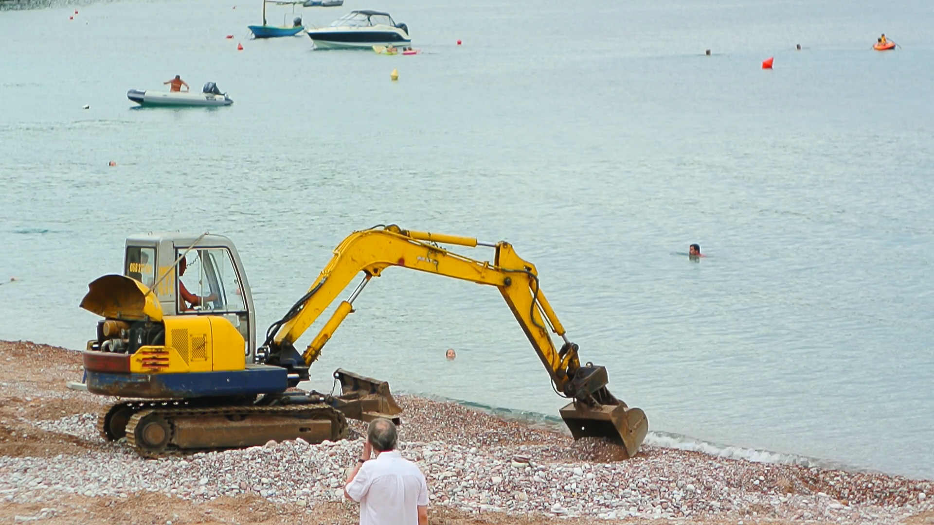 Yellow Excavator on the beach digging pebbles Stock Video Footage ...