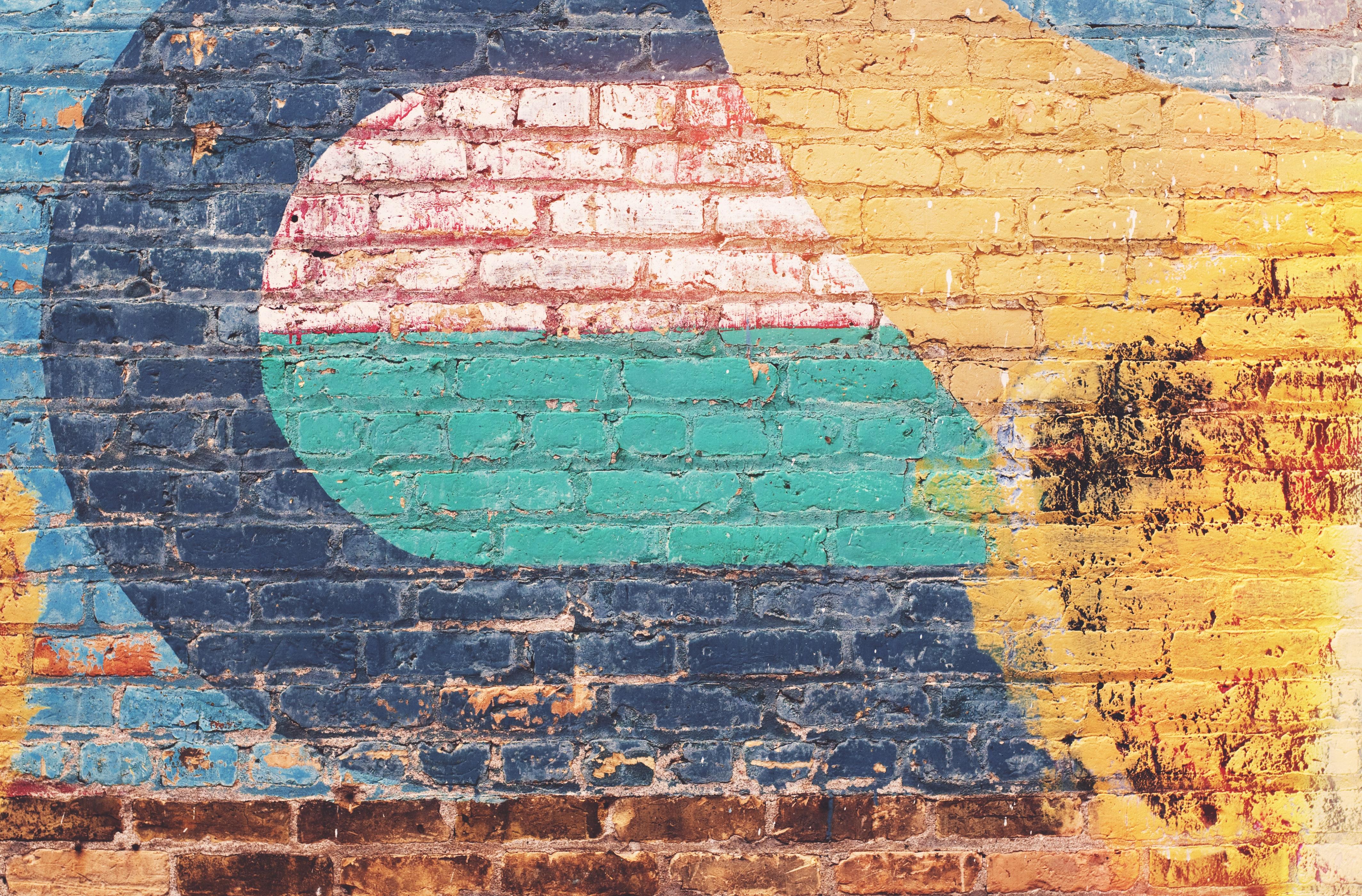 Yellow green and blue brick wall photo