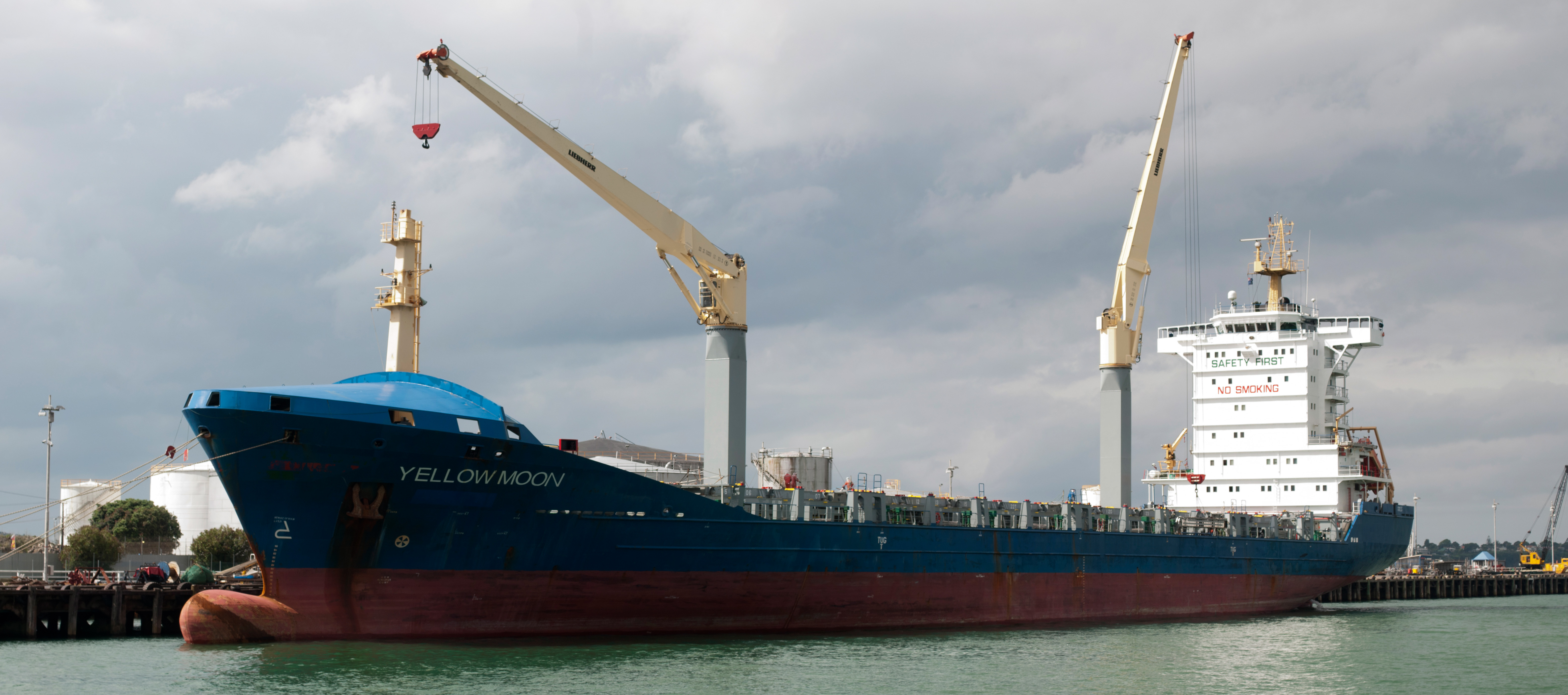Yellow moon container ship docked in auckland harbour photo