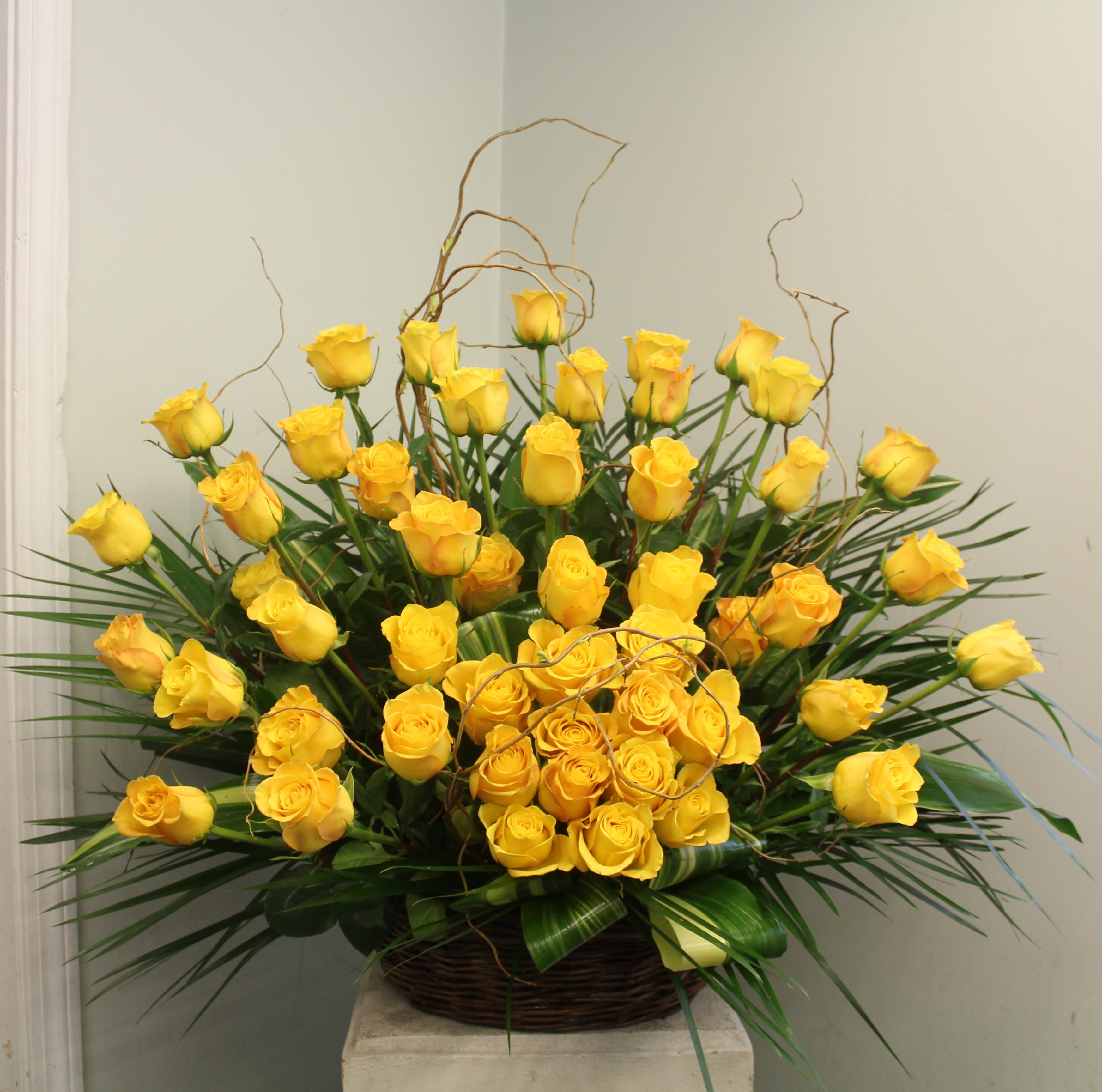 Evans Yellow Rose Wicker Funeral Basket in Peabody, MA | Evans Flowers