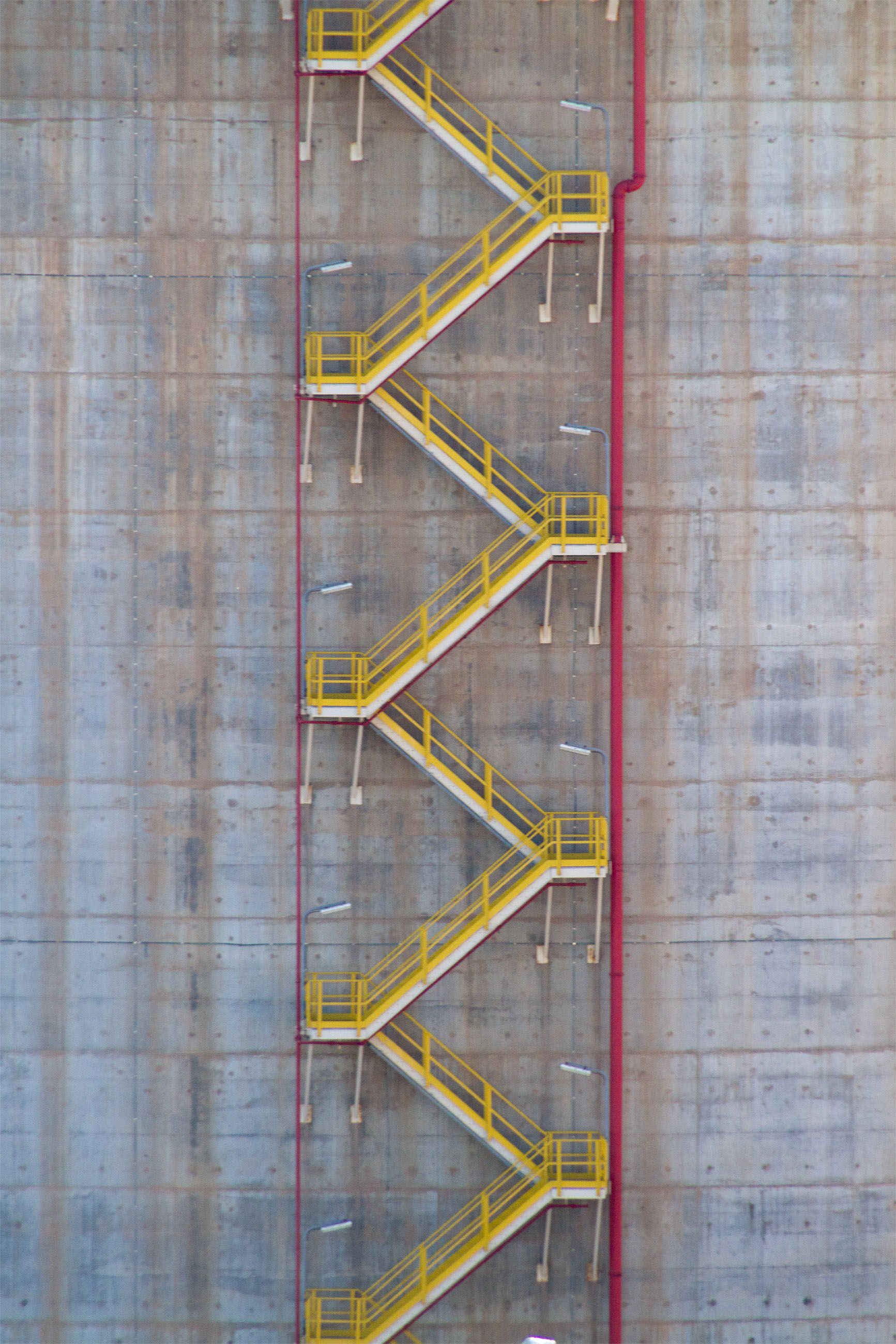 Yellow stairs on storage tank photo