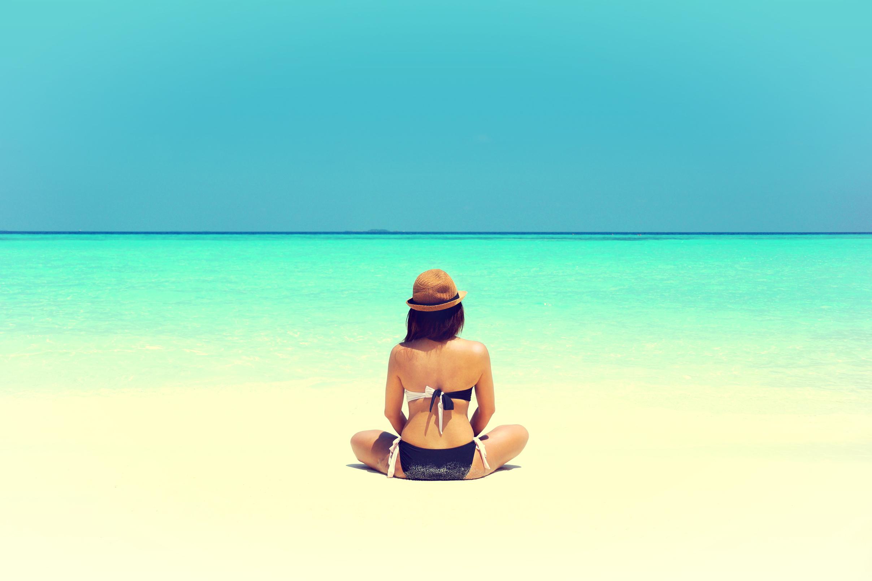 Yoga on the beach - woman alone photo