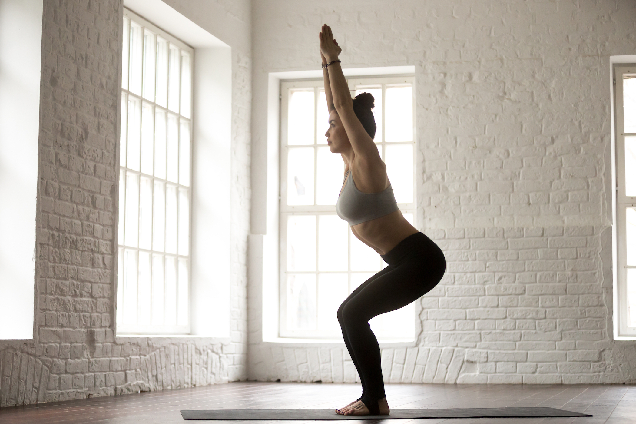 4 Super Easy Yoga Poses You Should Do Before Bed For A Flat Stomach