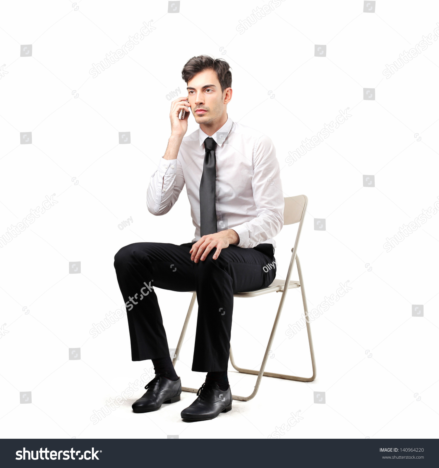 Young Businessman Sitting On Chair Talking Stock Photo (Royalty Free ...
