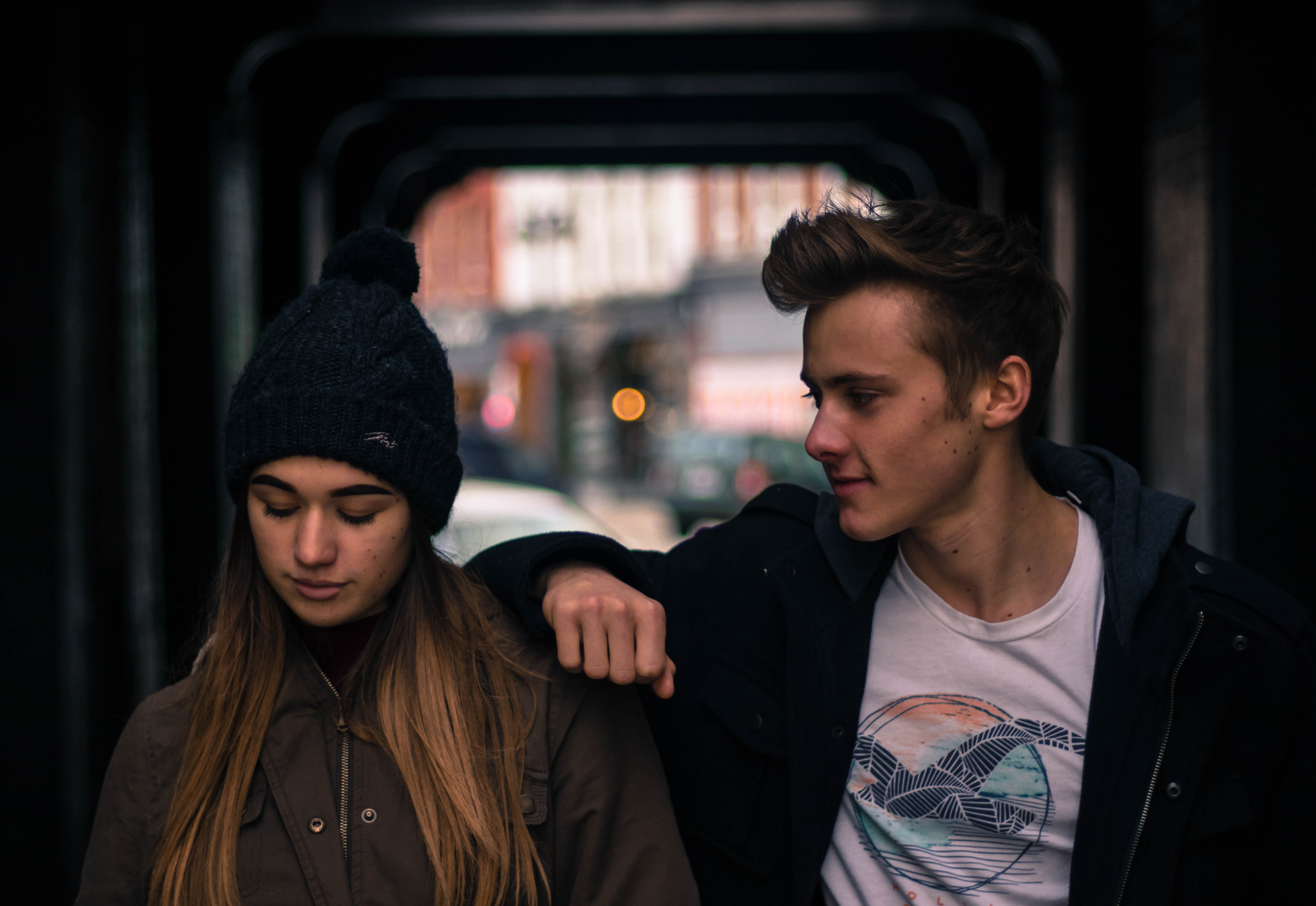 Young couple in city at night photo
