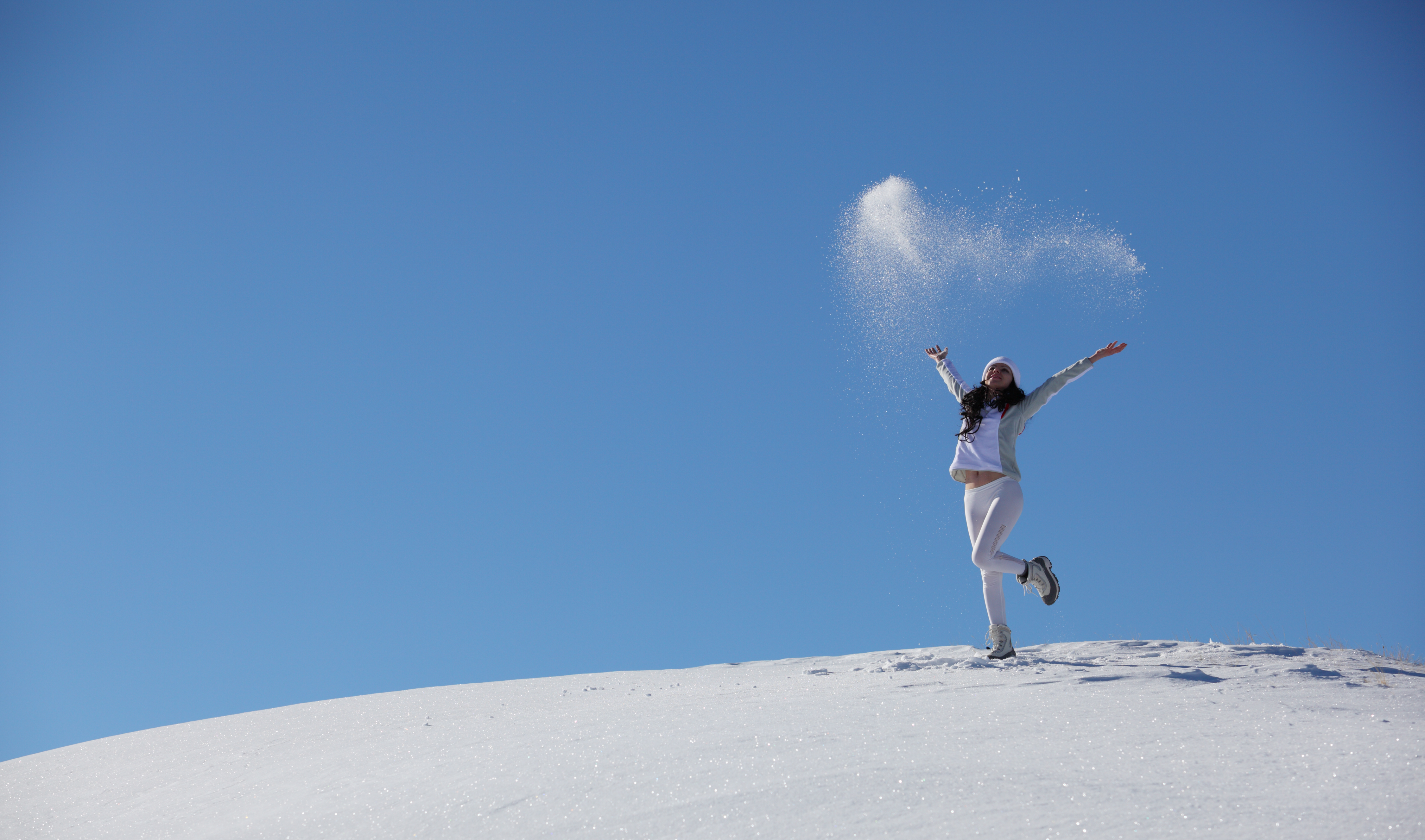 Young happy girl plays with snow photo