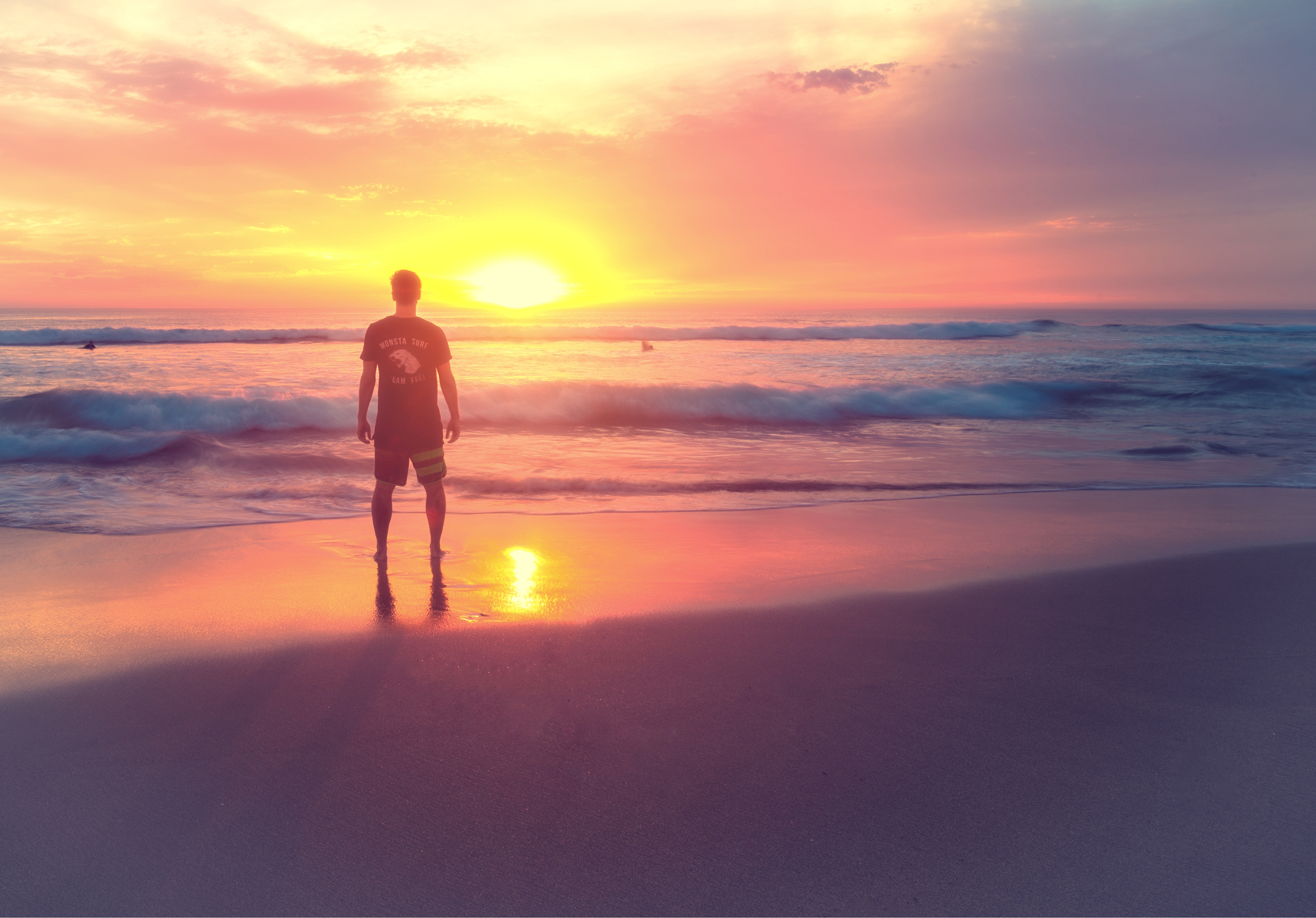 Young man at sunset on the beach photo