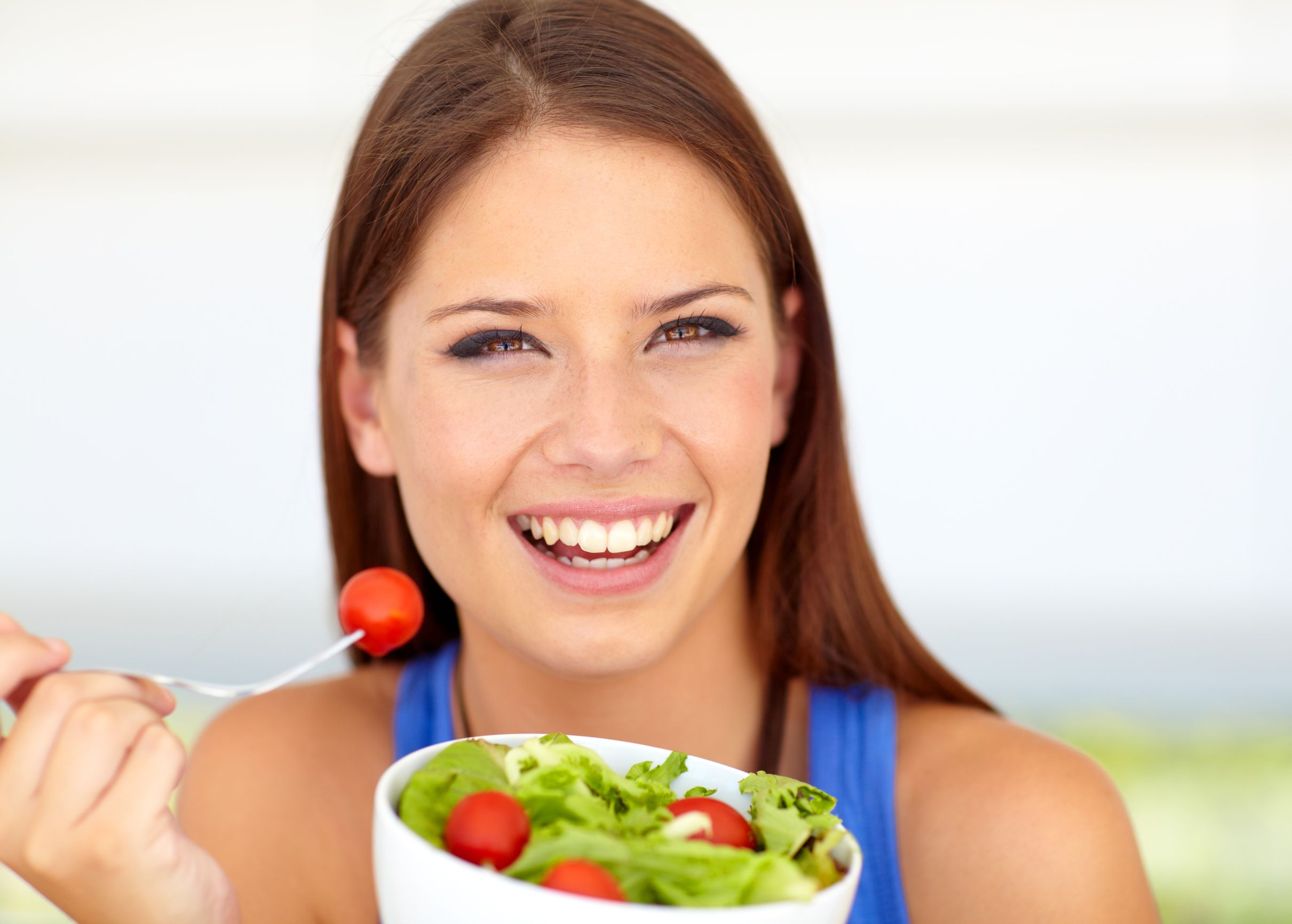 Lovely young woman enjoying a healthy green salad | Health&Fitness Talk