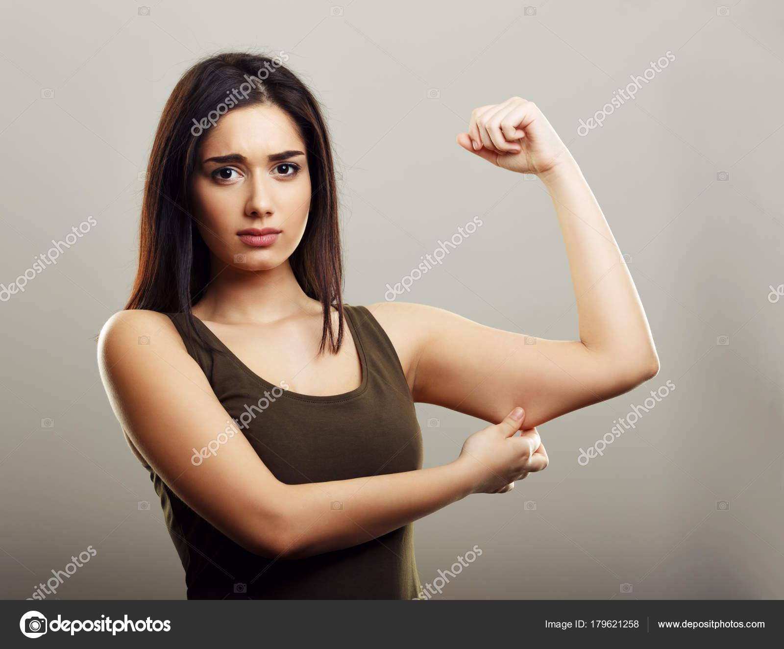 Young woman pinching arm fat skin — Stock Photo © dundanim #179621258