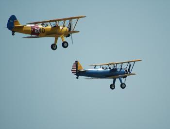 2 Biplanes Flying