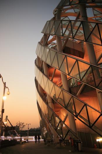 2 Person Walking Beside Dome Shape Designers Building