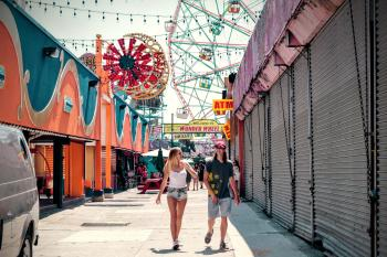 2 Women Walking in the Carnival during Daytime