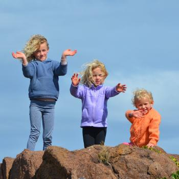 3 Kids Standing on Rock