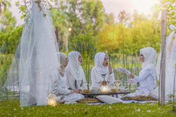 4 Women in White Abaya Wedding Gown Having Picnic Near Trees