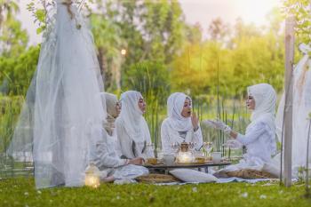 4 Women in White Abaya Wedding Gown Having Picnic Near Trees