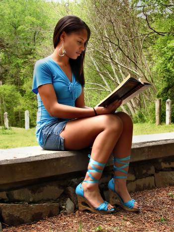 A beautiful teen girl reading a book