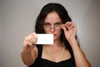 A beautiful woman holding a blank card
