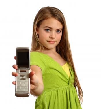 A beautiful young girl holding a cell
