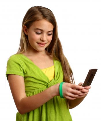 A beautiful young girl texting on a cell
