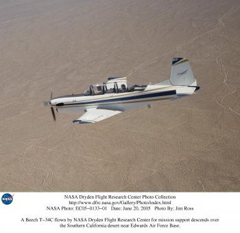 A Beech T-34C flown by NASA Dryden Flight Research Center for mission support descends over the Southern California desert near Edwards AFB.