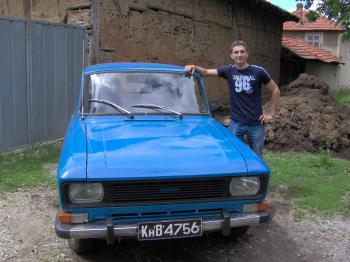 A boy with car in the village