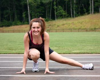 A cute young girl doing stretches