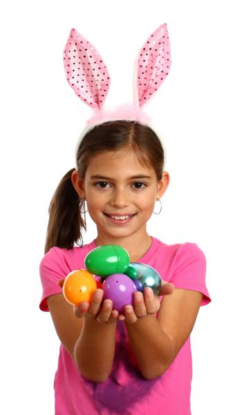 A cute young girl holding Easter eggs