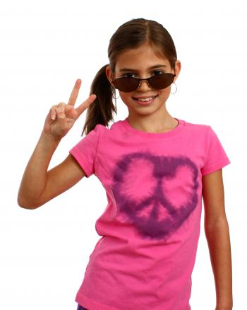 A cute young girl making a peace symbol