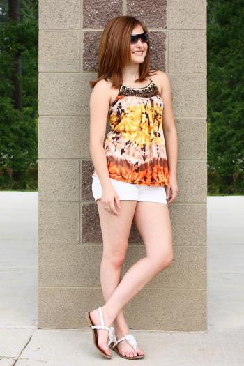 A cute young girl posing outdoors
