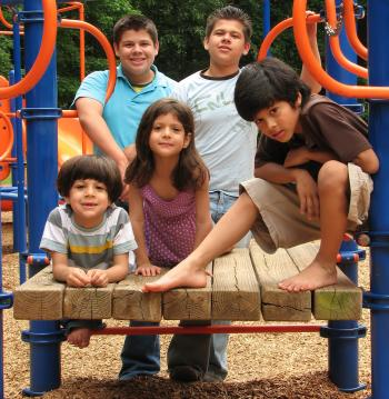 A group of kids posing on a playground
