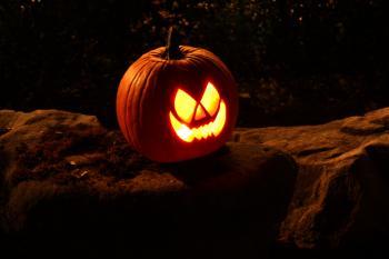 A Halloween jack-o-lantern on a rock